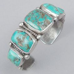 Stamped silver turquoise row bracelet with five stones