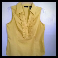 Top,New York company  Med. Mustard  in color,60%cotton 35%polyester, 5%spandex New York & Company Tops