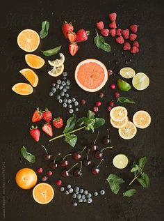 Colorful mix of fruits on black background. View from above.