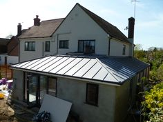 ZINC&SEAM are skilled contractors of the installation of standing seam and roll cap systems,offering a choice of ventilated or warm roofing & high quality Zinc and Copper craftsmanship. Bungalow Extensions, House Extensions, Metal Roof Cost, Zinc Roof, Conservatory Roof, House Cladding, Zinc Cladding, Roof Extension, Extension Ideas