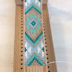 boncuk kolyeler video beads This video shows how Tower Creations maker TC Davis creates a Loom woven bracelet. Bead Loom Bracelets, Woven Bracelets, Loom Bands, Seed Bead Jewelry, Jewelry Case, Seed Bead Crafts, Bead Loom Patterns, Beading Patterns, Beaded Bracelet Patterns
