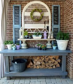 Cool potting bench..clever how she made a shelf from two urns and a piece of wood!