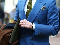 It's all about accessories. A bright blue suit with a green necktie. The whale tie bar and colorful pocket square really make this look stand out. #MilanFashionWeek