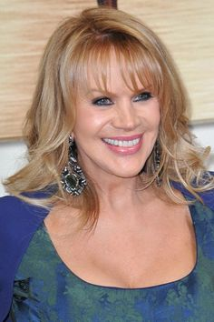 long layered haircut with bangs for older women