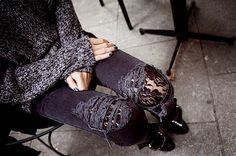 torn black jeans lace tights bulky sweater