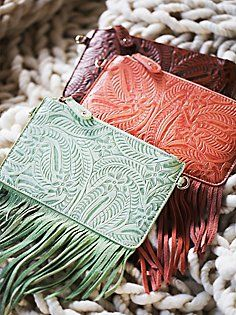 Shop Free People's beautiful boho bags, fringe purses, vegan totes, and more. Accessorize your outfit with a statement handbag that you could carry forever! Tooled Leather Purse, Leather Tooling, Leather Purses, Leather Crossbody, Leather Wallets, Popular Purses, Boho Trends, Fringe Purse, Boho Bags