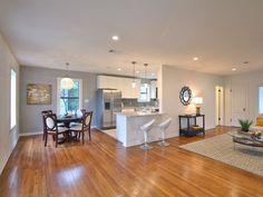 Transitional Great Room with Integra Raised Panel, High ceiling, Hardwood floors