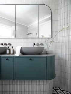 A curvaceous ensuite bathroom with a teal vanity joinery and hexagonal marble-mosaic tiled walls. Bad Inspiration, Bathroom Inspiration, Bathroom Renovation Cost, Bad Styling, Manufactured Home Remodel, Style Minimaliste, Bathroom Trends, Bathroom Designs, Classic Bathroom