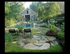 Dream backyard with barn style pool house