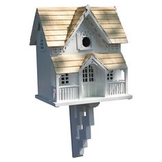 "BIRD HOUSE – Offer feathered friends a cozy abode with this beautifully crafted birdhouse. Showcasing pine shingles and a chic white finish, this charming design features a gingerbread cottage silhouette. Product: Birdhouse Construction Material: Exterior grade ply-board, kiln-dried hardwoods, pine, polyresin, and Western red cedar Color: White and natural Features:  Removable back walls for easy cleaning Ventilation and drainage1.25"" Hole openings designed to accommodate common birds"