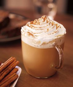 Starbuck's Cinnamon Dolce Latte - only 260 calories for a 16 oz.  Sweet cinnamony indulgence.  (You can always skip the whipped cream.)