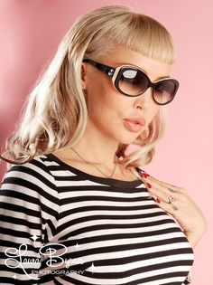 Bombshell Sunglasses in Black and White from Tres Noir - Tres Noir sunglasses are handcrafted on a small scale with a metal core, the strongest acetate plastic, and the best European plastic lenses available.  Full UV protection and a long-lasting quality you can feel as soon as you put them on.   The Bombshell style features black and white frames with gradient smoke lenses.