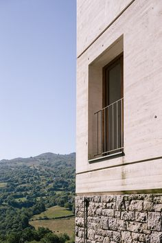 Spanish farmhouse updated with white concrete and pale local stone