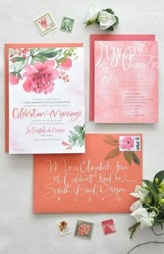 Pink and orange watercolor floral wedding invitations.