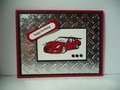 Red race car mounted on embossed aluminum, masculine card for men or boys