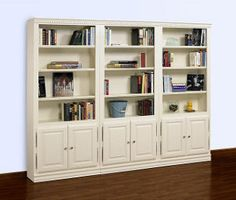 White living room shelving filled with books and other accent pieces