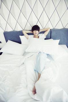 Boyfriend's Kwangmin makes fans swoon in bed pictorial