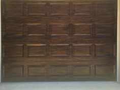 Aluminum Garage Doors painted to look like Stained Wood by Holly Blanton Art 904-294-5511