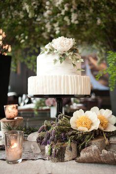 Wedding cake table display with fresh flowers