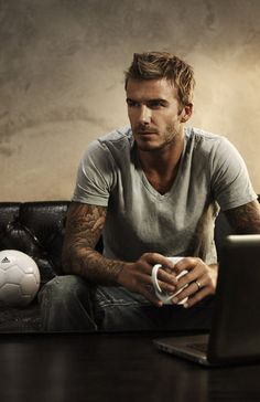 David Beckham. This photo captures so much. He's the athletic guy, the tatted up bad boy, yet the trustworthy laid back husband all while just sitting on a couch like he's nobody special.  ahhhhhh. the perfect man. :D