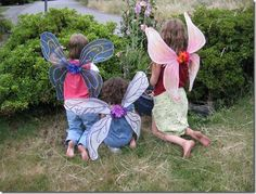 DIY butterfly wings with coat hangers, nylons, modge podge and elastic.