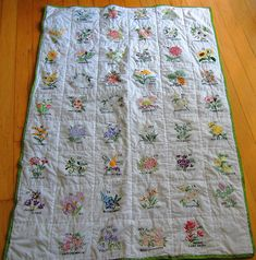 I love stitched things, flowers, and quilts and this lovely thing includes all three! I might have to make some of these myself.