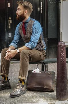 Something as simple as opting for a brown plaid wool waistcoat and brown chinos can potentially set you apart from the crowd. To break out of the mold a little, go for a pair of dark brown leather work boots.   Shop this look on Lookastic: https://lookastic.com/men/looks/waistcoat-denim-shirt-chinos/14331   — Dark Brown Leather Work Boots  — Navy and Yellow Socks  — Brown Chinos  — Black Leather Watch  — Light Blue Denim Shirt  — Brown Plaid Wool Waistcoat  — Red Tie