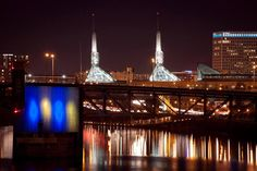 The Morrison Bridge and spires of the Oregon Convention Center in downtown Portland. Downtown Portland, Convention Centre, Oregon, Bridge, Tower, Photography, Rook, Photograph, Bridge Pattern