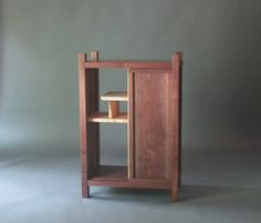 Our entry storage cabinet features a sliding door and unique display shelving. A wonderful solid wood hall table cabinet or bed side table with bookcase. The sliding door of this mid century modern accent cabinet lets you close half of the cabinet at a time. -Striking walnut wood grain patterns bring art and function together. -Modern sliding door can create closed storage while displaying art, photos or keepsakes -The fine craftsmanship of our Signature Visible Joinery is seen in the…
