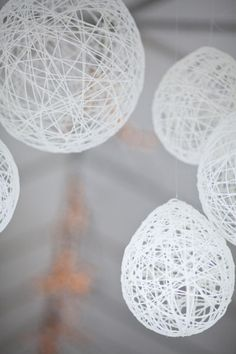 These lanterns look like perfect SNOW BALLS - great decor idea for winter wonderland wedding string-wrapped papier mache balloons/lanterns - if i get motivated!