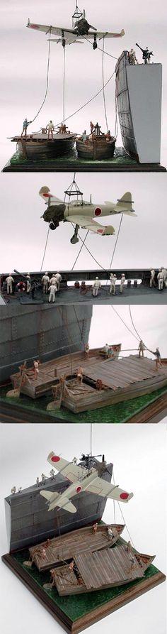 1/144 零戦21型, 09 06, 2008 | DIORAMA2  輸送船から陸揚げのためにハシケに移される零戦21型。当時の写真を参考に変わった構図で構成しています。釣り下げられているように見える機体は実は垂れ下がった3本のロープ(ギターの弦)で下から持ち上げられています。スケール1/144 100mm×100mm The airframe is not hung on.It is lifted from the under with three bowstrings of the guitar. scale1/144 4inch×4inch