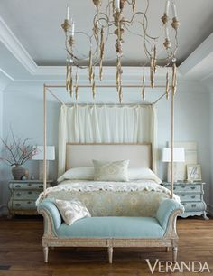 Tranquil Hues: The gilded four-poster in the master bedroom seems to float above reclaimed French wood planks.
