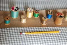 Haylie shared on Design Sponge how she upcycled several wooden thread spools into wall hooks.