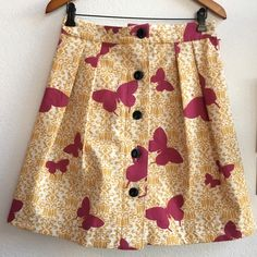 Handmade Yellow Butterfly Vintage Inspired Skirt Such a darling skirt! Purchased from a fellow artist at an art show last year, she does amazing work. Great attention to detail and solid styling, this skirt is made of a thick canvas cotton with cute black buttons down the front. Size small, waist is 30 inches. Fits me well, but I have yet to wear it! New with artist tags. 😍 Handmade Skirts A-Line or Full