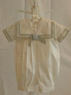 Boy's Silk Bubble    Absolutely stunning!  This 100% silk ivory bubble is trimed in a light blue.  It comes with a matching cap.    Perfect for Christenings or any other special occasion.    This will definitely become a family heirloom.