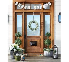 Make your Easter guests feel special the moment they reach your doorstep. Set a welcoming scene with a cheery banner, beautiful topiaries and a chic spring wreath to complete the look.