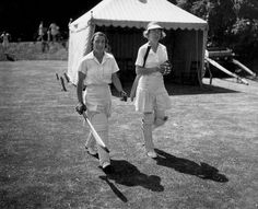 189 made by England's Betty Snowball against New Zealand. In pic: June 1939 — Snowball (left), wicket-keeper for England, and T Dutton at a match at Arundel Castle in Sussex. (Photo by David Savill/Topical Press Agency/Getty Images) Birth Of Nation, England Cricket Team, Bat Photos, Arundel Castle, 20th Century Women, Rowing, Snowball, Walk On, British Style