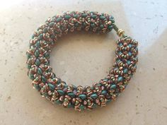 O-Caribbean Bracelet beaded by Elenia Cicirelli. Beautiful colors! Thank you for sharing!