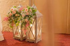 pretty lanterns with florals | Paul and Ann's pretty barn wedding at Larchfield | www.onefabday.com