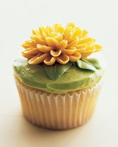 How-To  Chrysanthemum Cupcakes    Rather than poke up through the soil, icing flowers emerge, petal by petal, from the shiny tip of a pastry bag. Still, each little bud, smelling of sweet butter, seems as miraculous as one of nature's own.