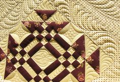 this blocks looks not to hard and the combination of fabric selected and quilting makes for an awesome quilt.