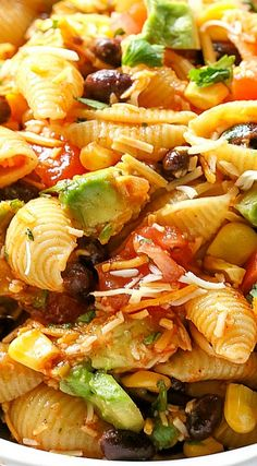 Taco Pasta Salad ~ filled with black beans, corn, cilantro, avocados, and tomatoes. It's tossed in a vinaigrette and sprinkled with cheese.