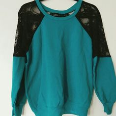 Lace Sweatshirt SUPER CUTE Urban Renewal Sweatshirt with a vintage look. Teal base with lace sleeves and 1/2 lace back. Could easily fit someone who is a M/L because of its oversized loose fit. Not brandy Melville. Brandy Melville Tops Sweatshirts & Hoodies