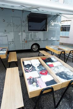 "Rapha recently commissioned a ""Mobile Cycle Club"" - a converted truck outfitted with the latest technology. The design features a retractable awning and 60"" flatscreen for viewing races via satellite, as well as glass cases to display Rapha's products and matching benches for extended coffee breaks. Impressive."
