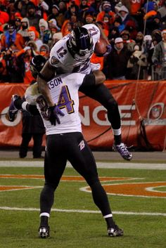 Ed Dickson #84 and Jacoby Jones #12 of the Baltimore Ravens celebrate after Jones scored a 70-yard touchdown reception in the fourth quarter against the Denver Broncos during the AFC Divisional Playoff Game