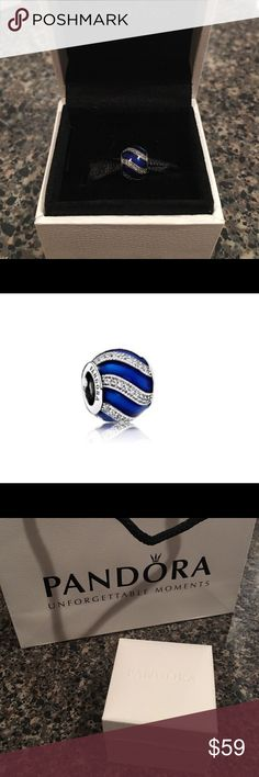 Pandora Adornment Sapphire Blue Charm Never used, box and bag included. A bright royal blue hue and a striking stone-studded ribbon embellishment gives this sterling silver charm a lavish expression. Offers welcome Pandora Jewelry