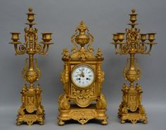 Lot 707: An exceptional Nap III period gilt bronze garniture, the dial marked 'Ancely Père et Fils- Toulouse', H 56 cm  € 2.000 - € 3.000
