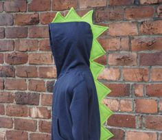 ORDER BY OCTOBER 6th to guarantee Halloween Delivery  This listing is for a Toddler Sized Dinosaur Hoodie ONLY. Links for Tails are listed below.  Our dress-up dinosaur/dragon hoodie is a favorite amongst our family and friends! Kids love to put the hoodie on a ROAR like a dinosaur! The bright colors are great to stimulate your childs imagination and allow them to go back in time with the dinosaurs. The spikes are made of a soft fleece so no one gets hurt during dinosaur play! Choose: 1…