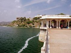 #Ana Sagar Lake is an artificial lake situated in the city of Ajmer in Rajasthan,India. It is was built by Anaji Chauhan, the grandfather of Prithvi Raj Chauhan, in 1135 -1150 AD and is named after him. The catchments were built with the help of local populace.The Baradari or pavilions were built by Shahjahan in 1637 and Daulat Bagh Gardens by Jehangir.There is an island in the center of the lake which is accessible by boat or water scooter.