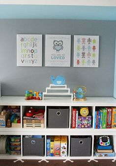 I really like the combination of bins and open shelves. The shorter height of the shelves makes it more accessible to the kids..